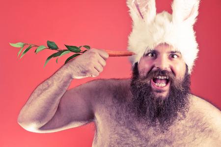 Suicidal bearded fat man wears silly bunny ears Stock Photo