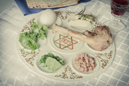 lamb of god: Jewish seder plate. Six foods make up this passover meal.