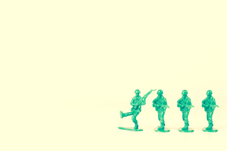 copycat: Green army leader steps off his foot stand and others follow Stock Photo