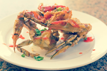 crab legs: Delicious Thai fried crab legs with sweet red sauce drizzle