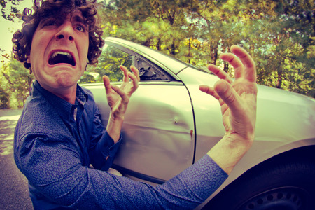 Silly man gets into car crash and makes ridiculous face