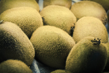 kiwis: Organic glowing kiwis on display at local farmers market