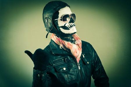 blaming: Blaming aviator with face painted as human skull