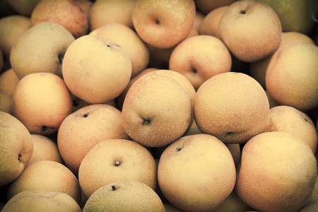 heap: Pile of juicy ripe Asian pears at local farmers market