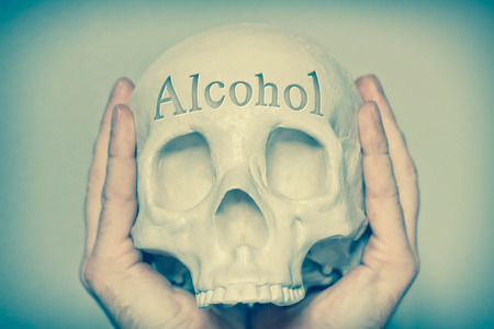 spells: Engraved word Alcohol on skull spells out cause of death