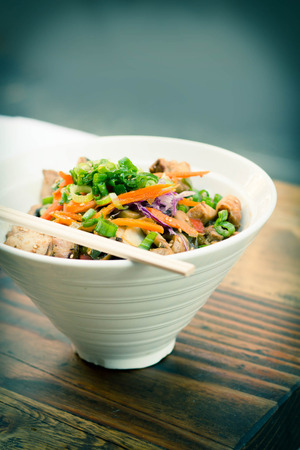 scallions: Korean Dak Bulgogi chicken rice bowl topped with fresh scallions