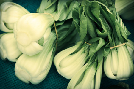 bok choy: Bunches of fresh organic bok choy in pile at local farmers market