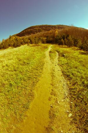 appalachian: Dirt path leading to Appalachian mountains on cool autumn day Stock Photo