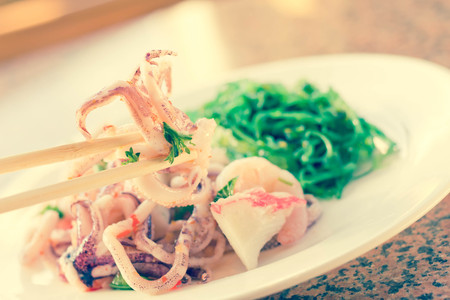 seaweed: Lobster shrimp and calamari seafood salad with sesame seaweed Stock Photo