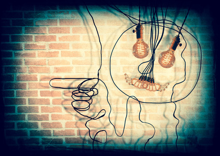 anthropomorphic: Smiling anthropomorphic face made from hanging edison light bulbs Stock Photo