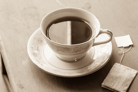 dainty: British black tea in a dainty tea cup and saucer