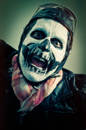 aviator: Angry aviator with face painted as human skull Stock Photo