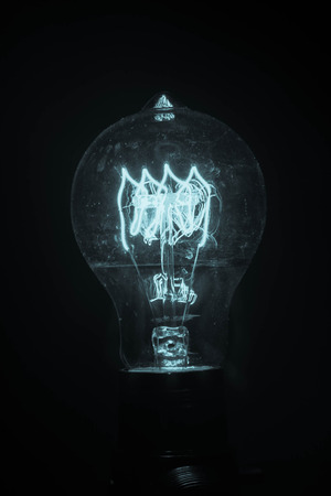 edison: Decorative antique edison style light bulb in dark room