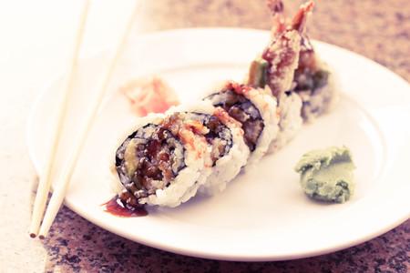 Shrimp tempura avocado sushi roll with sweet sushi sauce Stock Photo - 48893549