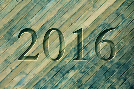 chiseled: Engraving for the new year 2016 on textured old surface