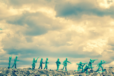 plastic soldier: Toy soldiers march along the horizon in war image Stock Photo