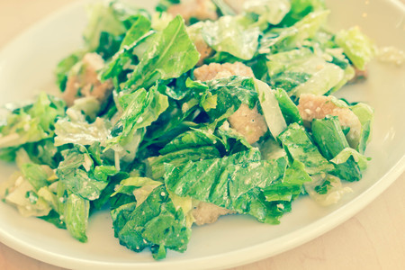 caesar salad: Fresh organic caesar salad with grated asiago cheese