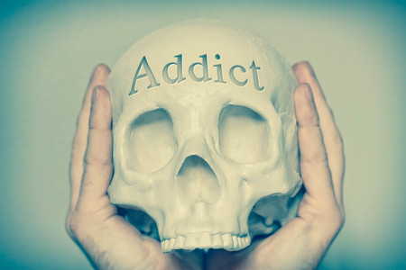 artistic addiction: Engraved word Addict on skull spell out cause of death