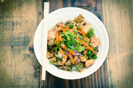 scallions: Korean Dak Bulgogi chicken rice bowl topped with fresh scallions