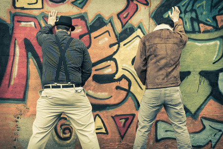 urination: Two snazzy stylish men relieve themselves in public