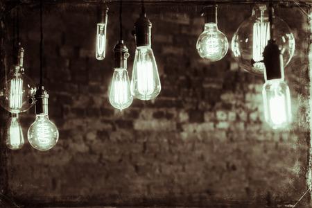 edison: Decorative antique edison style filament light bulbs against brick wall