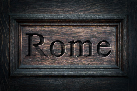 Engraving spelling the city Rome on textured old surface Reklamní fotografie