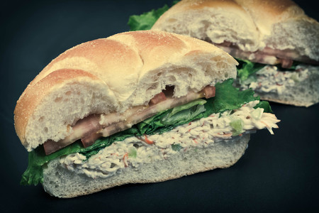seafood salad: Bound seafood salad sandwich with mayo on a kaiser roll
