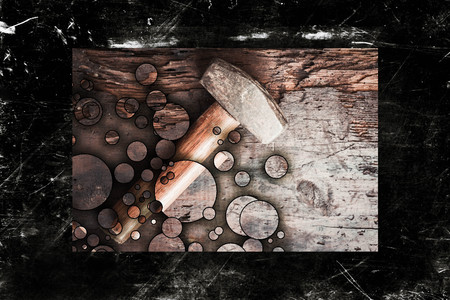 worn: Small single handed worn sledge hammer on grunge wood background