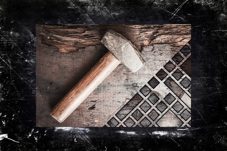 handed: Small single handed worn sledge hammer on grunge wood background