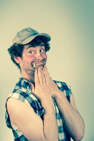 crush on: Embarrassed smoking redneck blushes as his crush passes Stock Photo