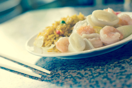 medley: Chinese seafood medley of shrimp calamari and lobster with fried rice Stock Photo
