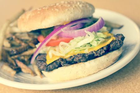 sesame seed bun: cheeseburger on sesame seed bun with lettuce tomato onions and potato skin fries
