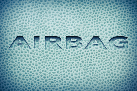 The word airbag written on car interior leather for safety image