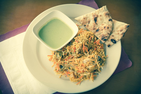 naan: Indian biryani chicken with naan and mint coriander chutney sauce