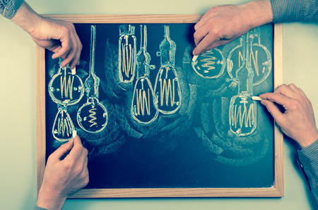 edison: Variety of antique edison style lightbulbs drawn on chalkboard