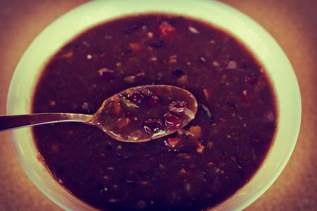 turtle bean: Fresh hot black bean soup in white bowl on kitchen table