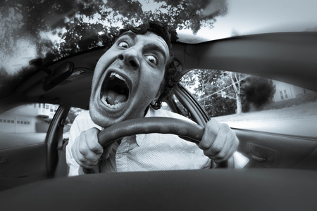 car trouble: Silly man gets into car crash and makes ridiculous face
