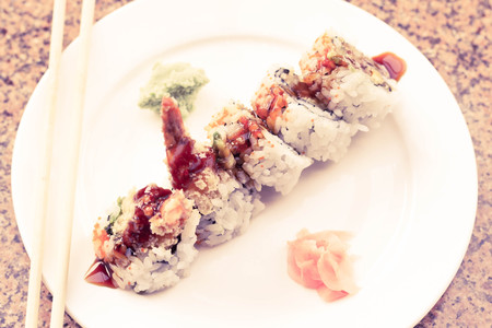 Shrimp tempura avocado sushi roll with sweet sushi sauce