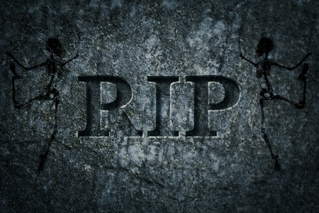 headstone: Engraved headstone spelling the letters RIP with Skeletons - rest in peace