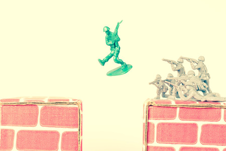 traitor: Green army man jumps ravine to escape gray army