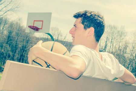 basketball game: Young man resting after exhausting basketball game