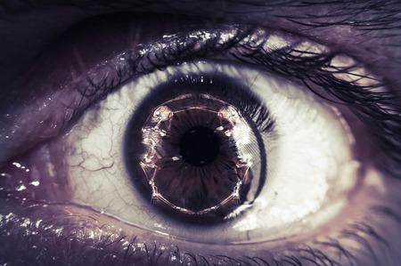 halloween eyeball: Halloween themed closeup macro shot of eyeball with skeleton reflection
