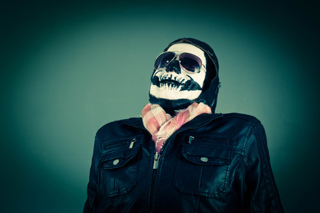disapproving: Scared Disapproving aviator with face painted as human skull