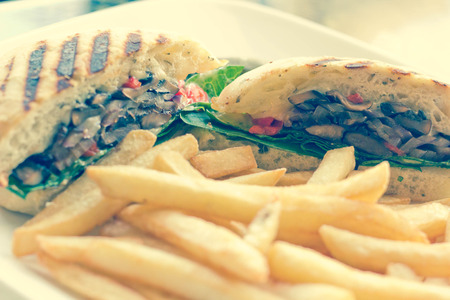 sanwich: Portobello mushroom sandwich on a toasted ciabatta bun and side of fries Stock Photo