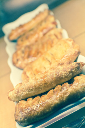 teacake: French triangle puff pastry with twists and powdered sugar