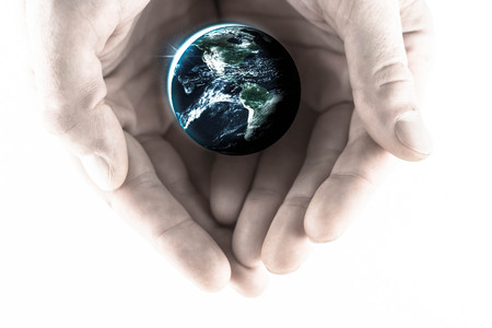 global health: Cupped hands holding planet earth in global health imagery, Elements of this image furnished by NASA