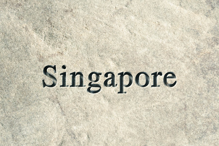 etch: Engraving spelling the city Singapore on textured old surface Stock Photo