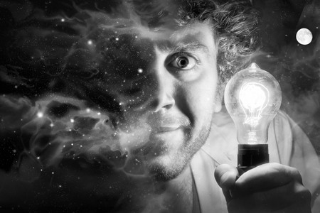 starscape: Crazy man holds edison style light bulb against beautiful universe of stars