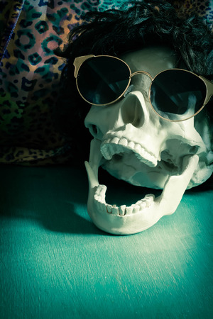 rockstar: Cool human skull relaxing like a rock star Stock Photo