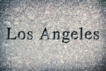 chiseled: Engraving spelling the city Los Angeles on textured old surface
